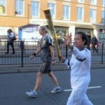 vadsana sinthavong carries olympic torch